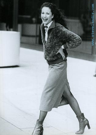early fashion photo of Andie MacDowell walking with smile