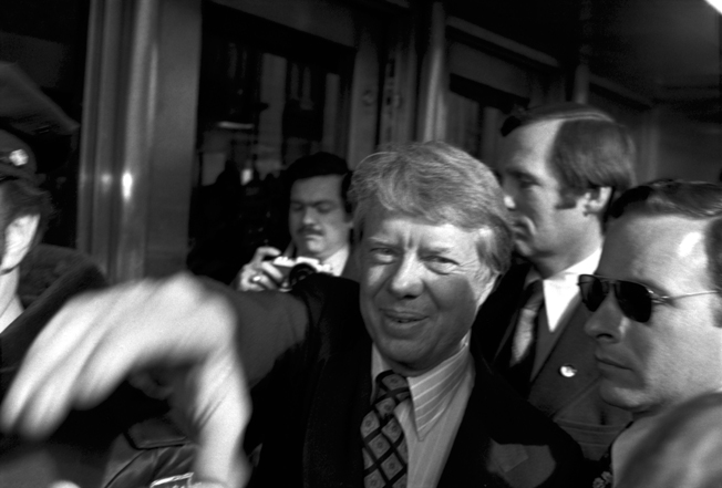 Soon to become, U.S. President jimmy Carter reaching out to photographer steve landis